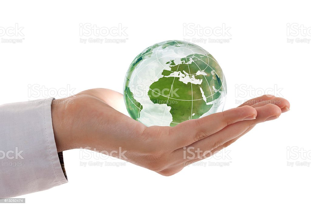 Earth globe (Europe view) in woman's hand stock photo