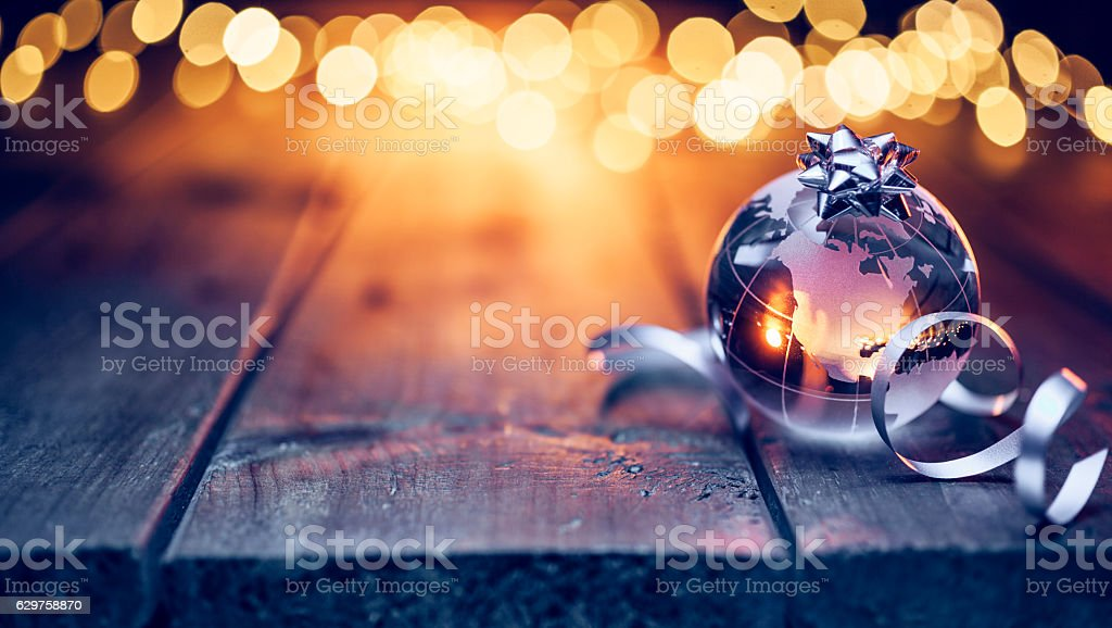 Earth globe on old table - Christmas Celebration Defocused wood stock photo