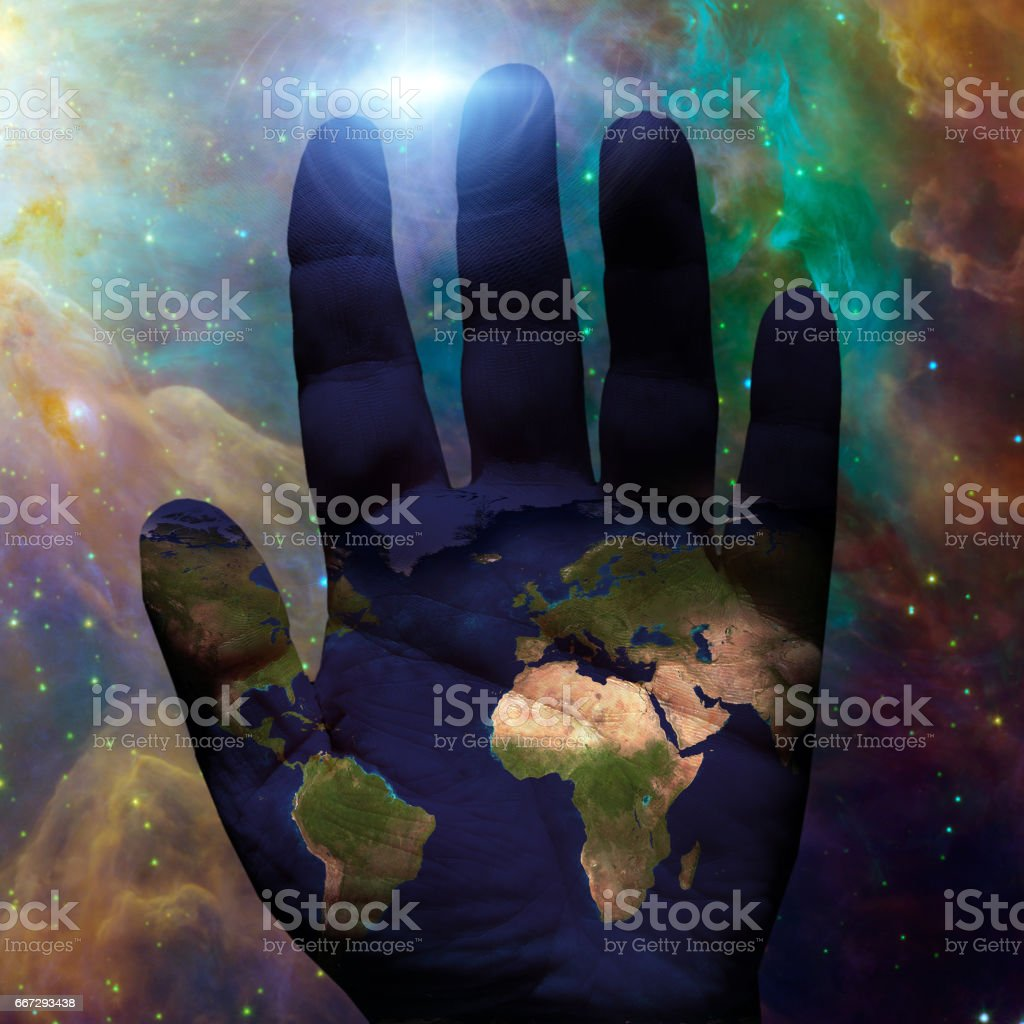 Earth hand galactic stock photo