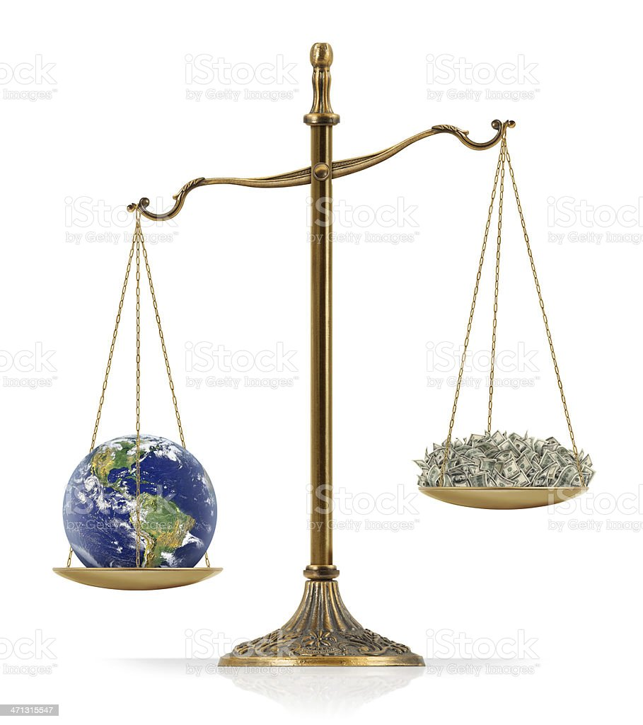 """Earth Heavier Than Money There is world globe at the one side of """"Scales of Justice"""" while there is money on the other side. In this version, world globe seems heavier than money. Isolated on white background. American One Hundred Dollar Bill Stock Photo"""
