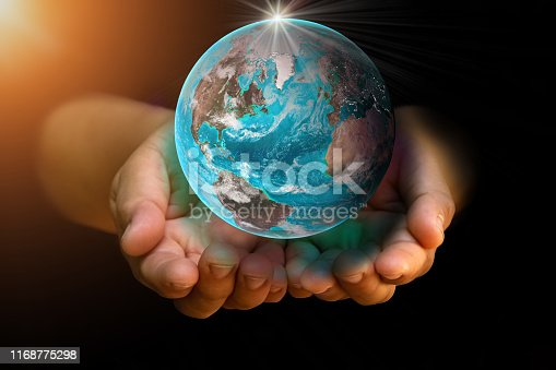 Earth holding in human on two hand at wait on black background. World environment day and green earth. Energy saving environment nature conservation concept. Elements of this image furnished by NASA.