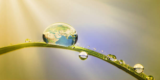 earth in a drop       (© Lobke Peers) conservation concept: the earth in a droplet of water environmental consciousness stock pictures, royalty-free photos & images