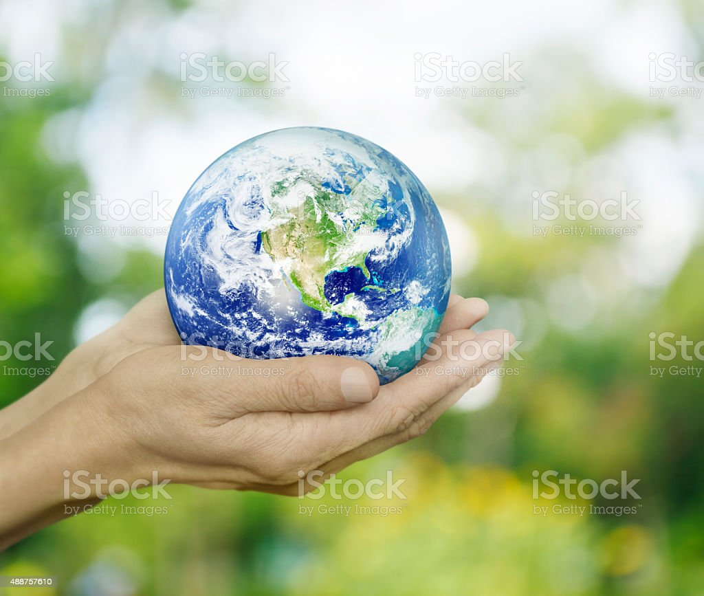 Earth in hands, Elements of this image furnished by NASA stock photo