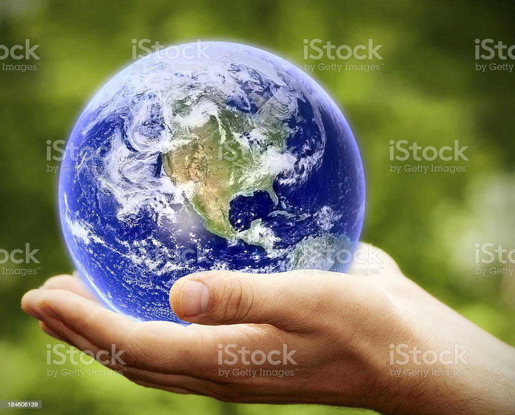 Earth in hands royalty-free stock photo