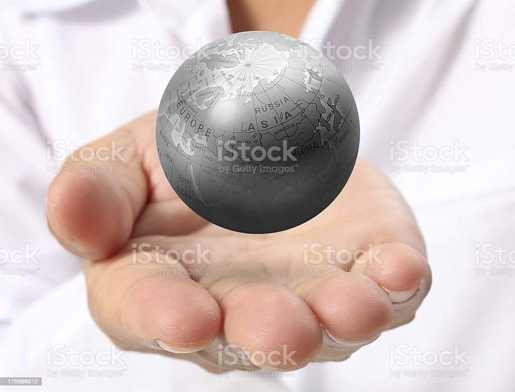 earth in human hand royalty-free stock photo