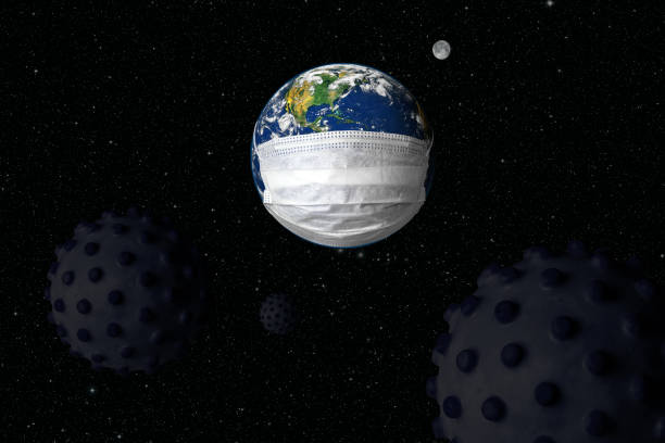 Earth in medical mask and dark germs, concept of safety, coronavirus in world and COVID-19 pandemic. Globe with protect from corona virus. stock photo