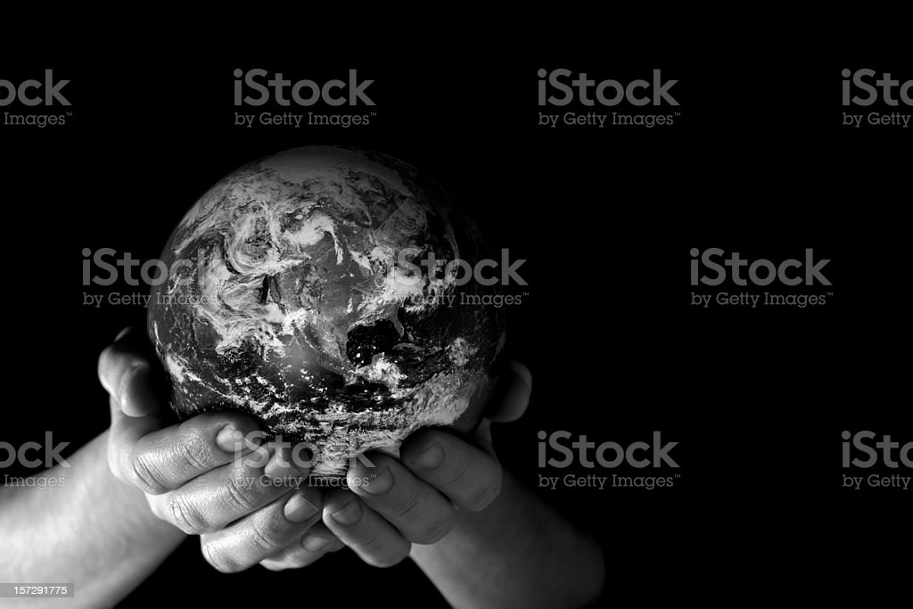 Earth in my hands (b/w) royalty-free stock photo