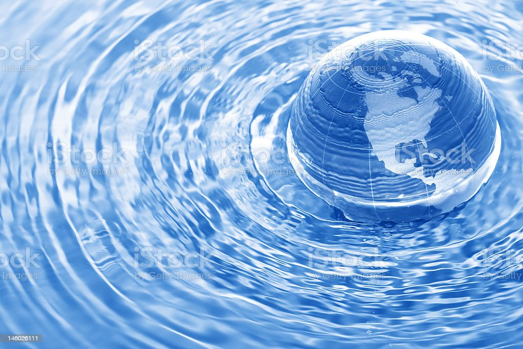 Earth in water stock photo