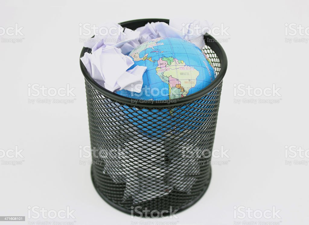 Earth into garbage basket royalty-free stock photo