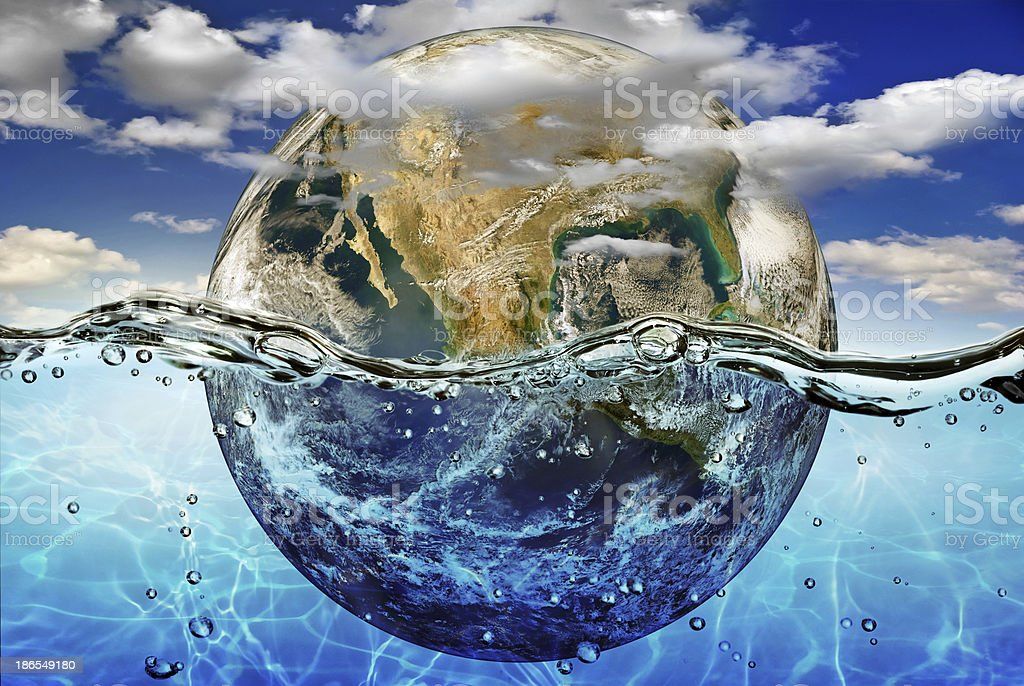 Earth is immersed in water, among clouds against the sky. stock photo