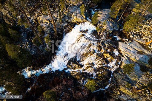 aerial drone views of Eagle Falls rushing down the Mountains during spring time snow melt in the Sierra Nevada Mountains  in Lake Tahoe , California , USA on a nice sunny spring time