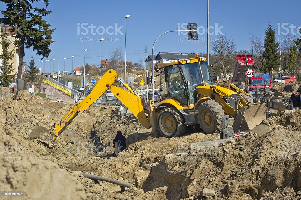 Earth Mover digging a ditch stock photo