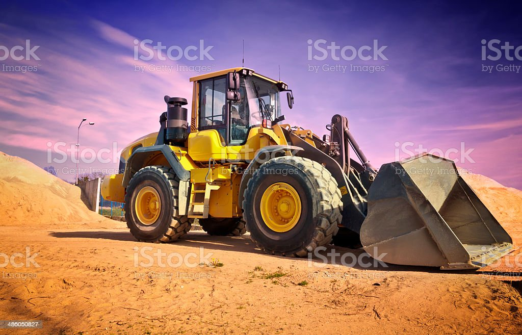 Earth mover in a new road construction stock photo