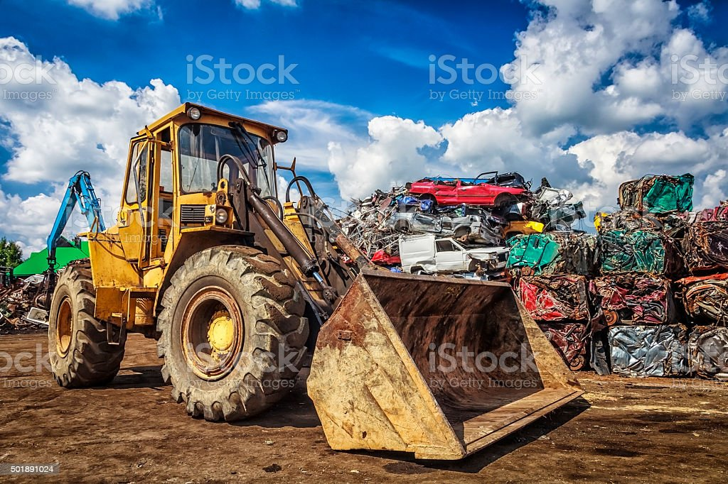 Earth Mover in the cars junkyard stock photo