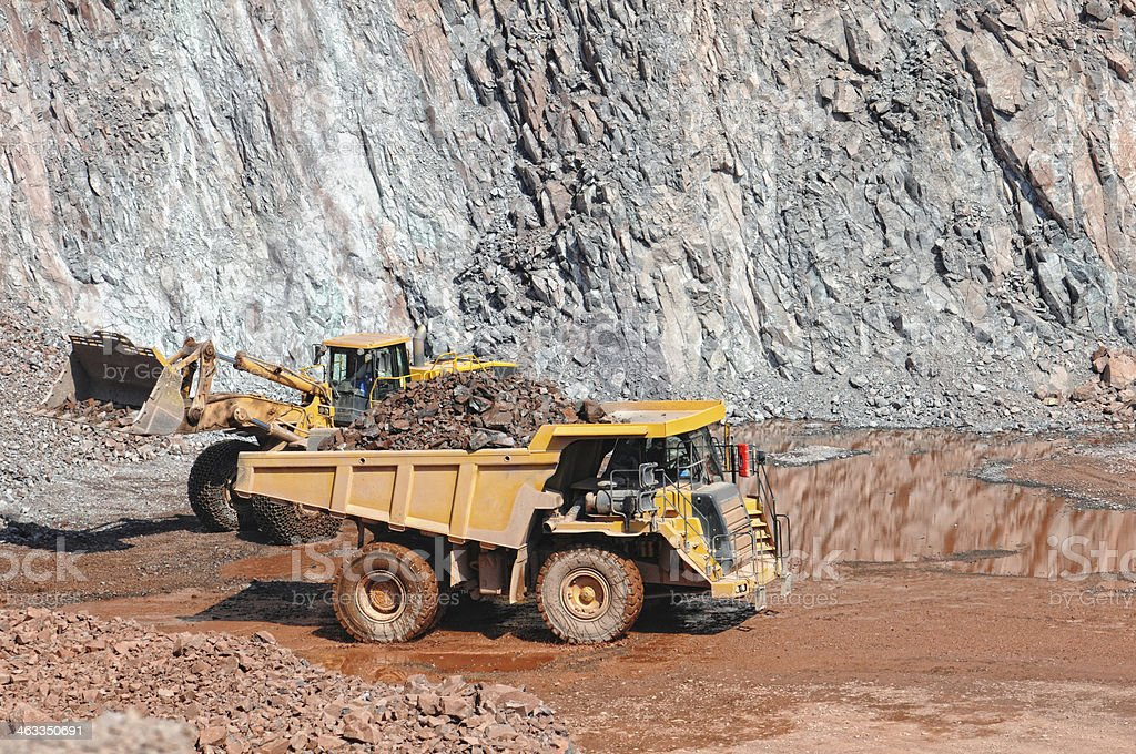 earth mover loading a dumper truck surface mine stock photo