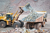Large quarry dump truck. Loading the rock in the dumper. Loading coal into body work truck. Mining truck mining machinery, to transport coal from open-pit as the Coal. Production useful minerals
