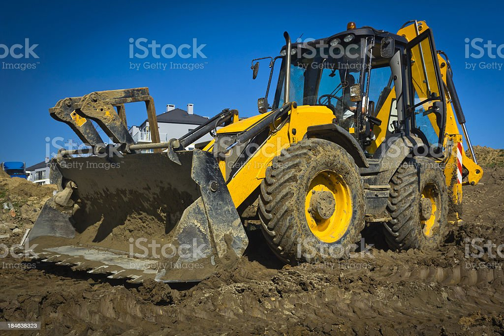 Earth mover working in a new road construction stock photo