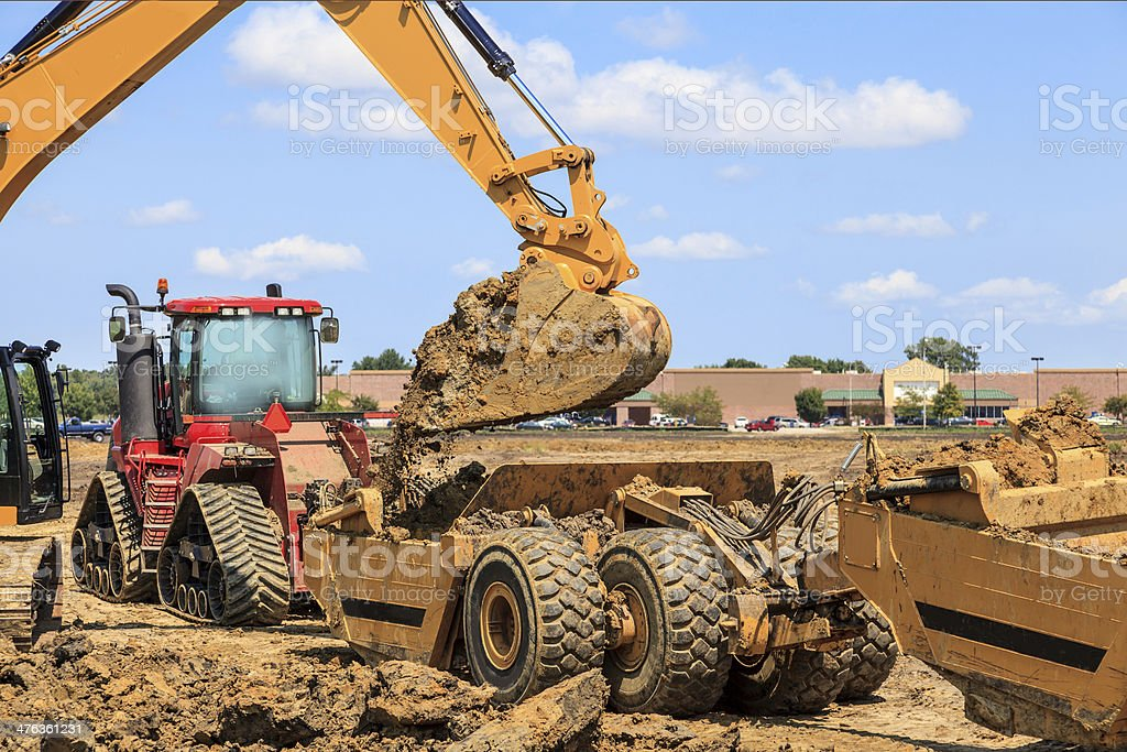 Earth Moving equipment being loaded with dirt royalty-free stock photo
