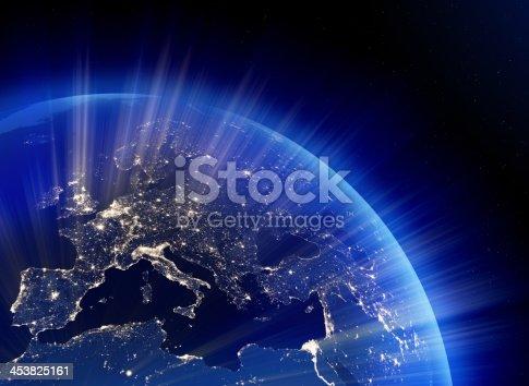 499002117istockphoto Earth nightlights emitting rays of light, Europe in focus 453825161