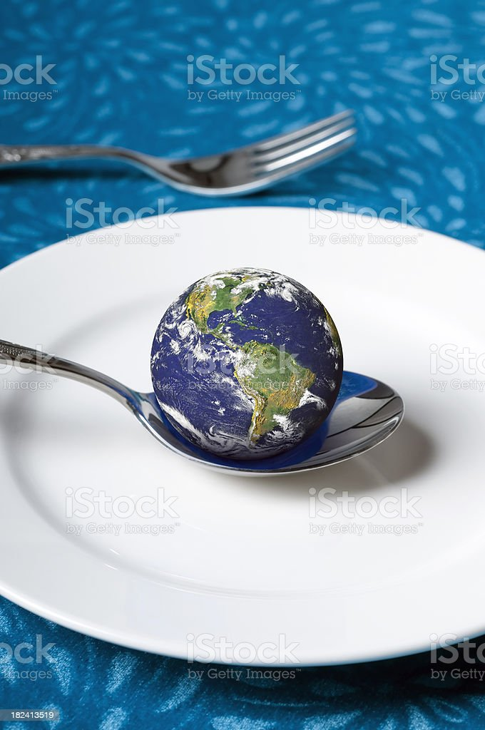 Earth on a spoon royalty-free stock photo
