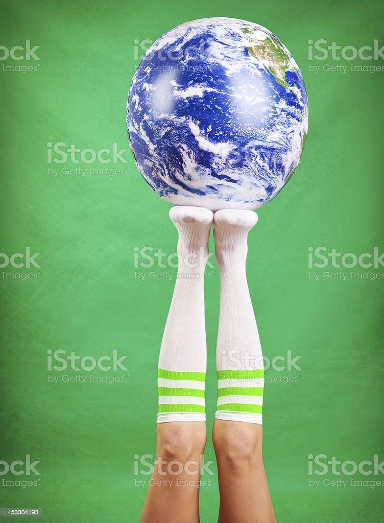 Earth On Woman's Feet stock photo