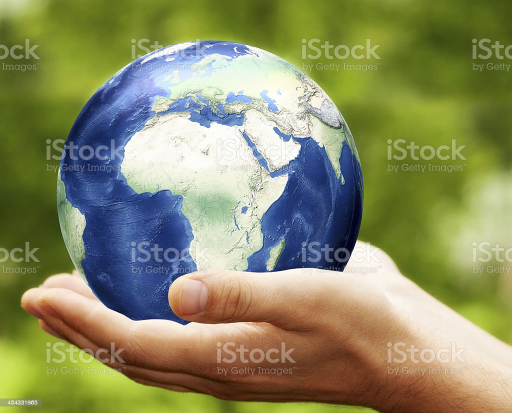 Earth Planet in Hands royalty-free stock photo