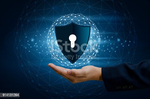 istock Earth polygon mesh planet World Businessmen shake hands to protect information in cyberspace. Businessman holding shield protect icon protection network security computer and safe your data concept 914131264