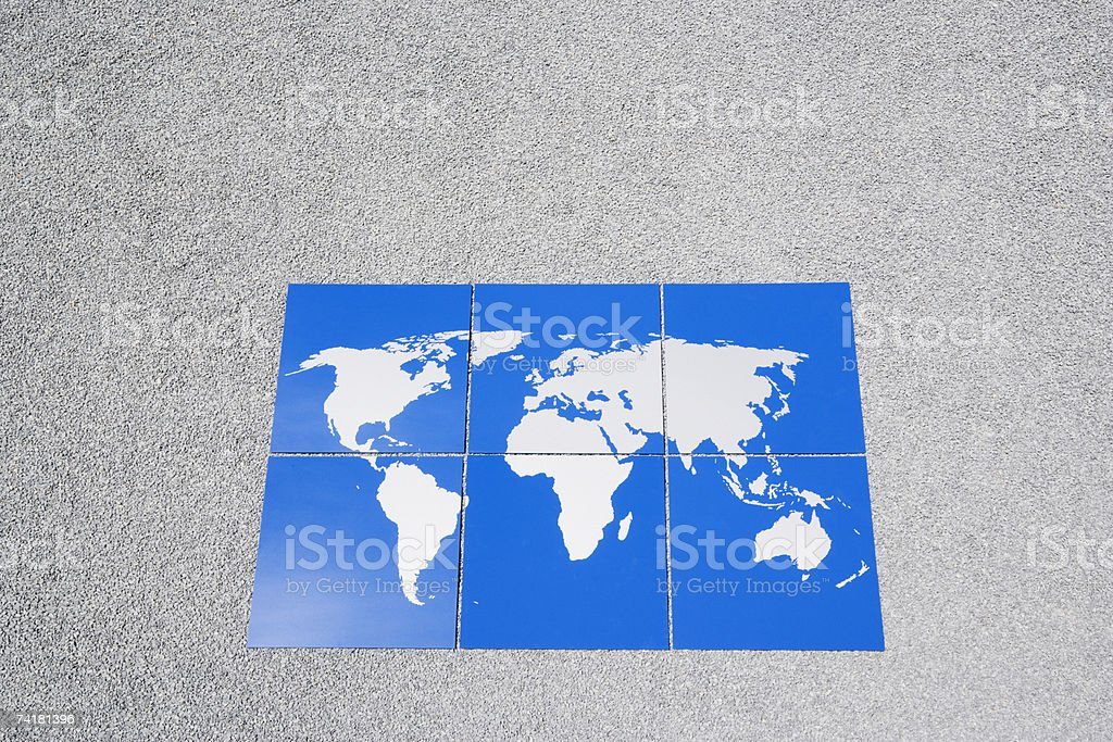 Earth puzzle on gravel outdoors royalty-free stock photo