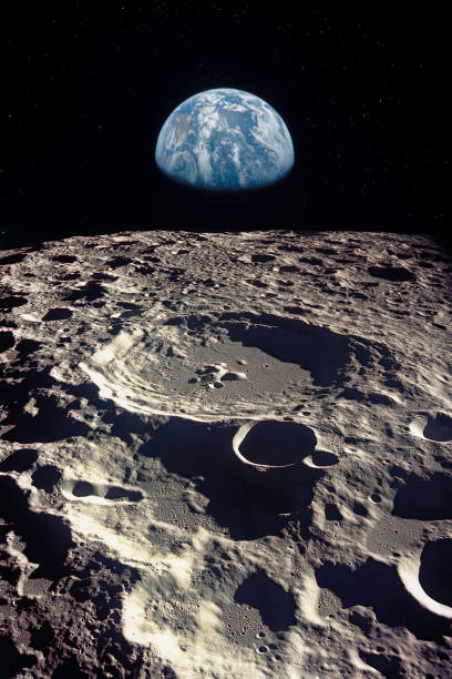 earth rises above lunar horizon.  elements of this image furnished by nasa. - moon stock pictures, royalty-free photos & images