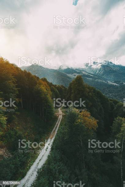 Photo of Earth road in mountains, view from top