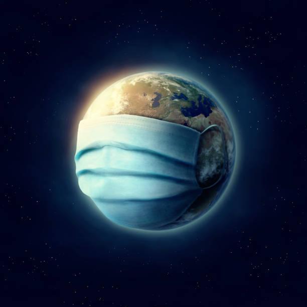 Erde trägt eine chirurgische Maske. Die von der NASA zur Welt eingerichteten Bildelemente – Foto