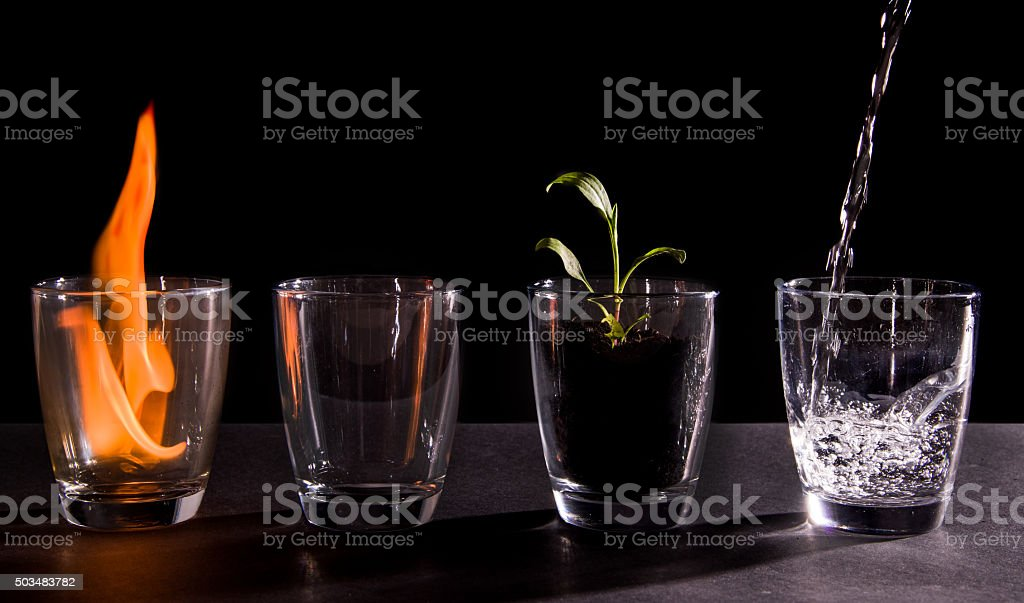 Earth, wind, fire and water stock photo