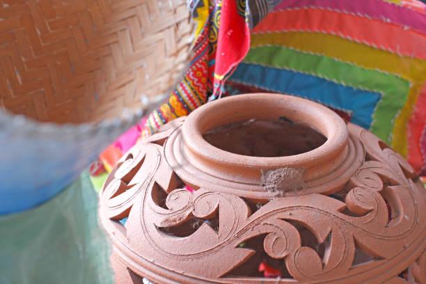 earthenware on old wooden floor is in the garden