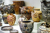 View of group of earthenware pots on display, Greece