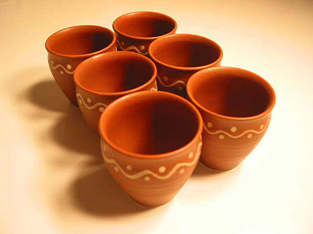 Earthenware - Six clay cups stock photo