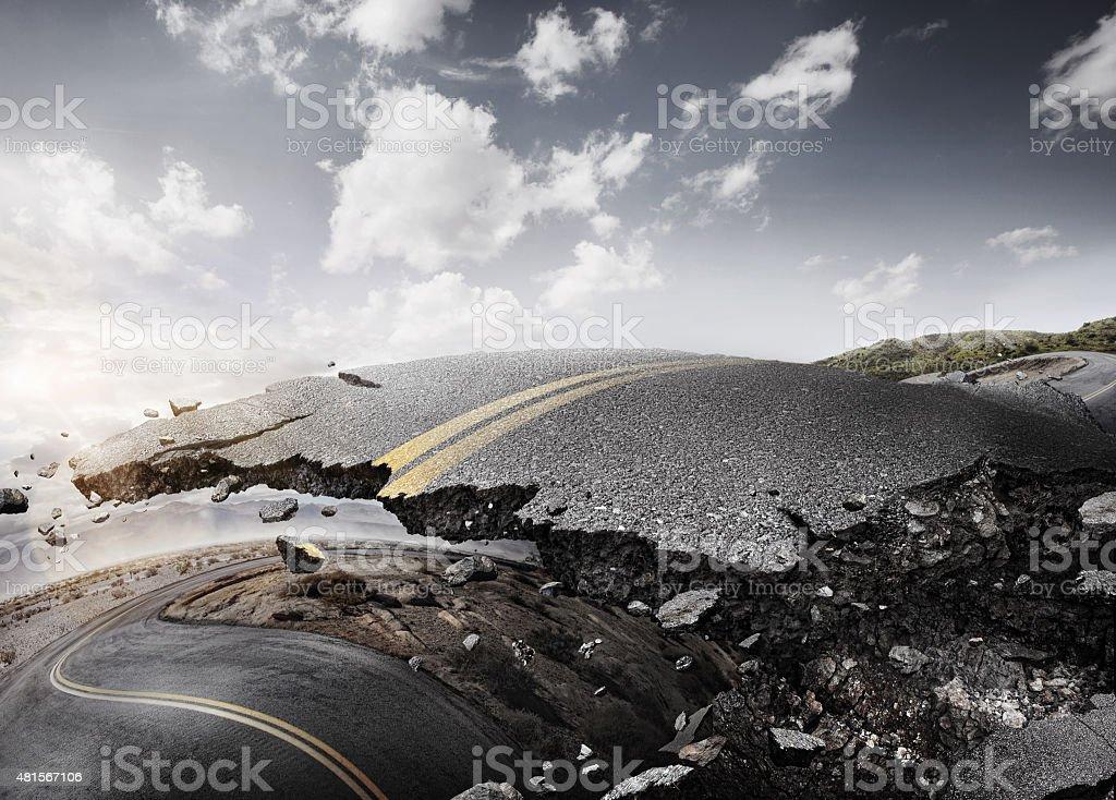 Earthquake. Crashed desert road. Cracked asphalt. stock photo