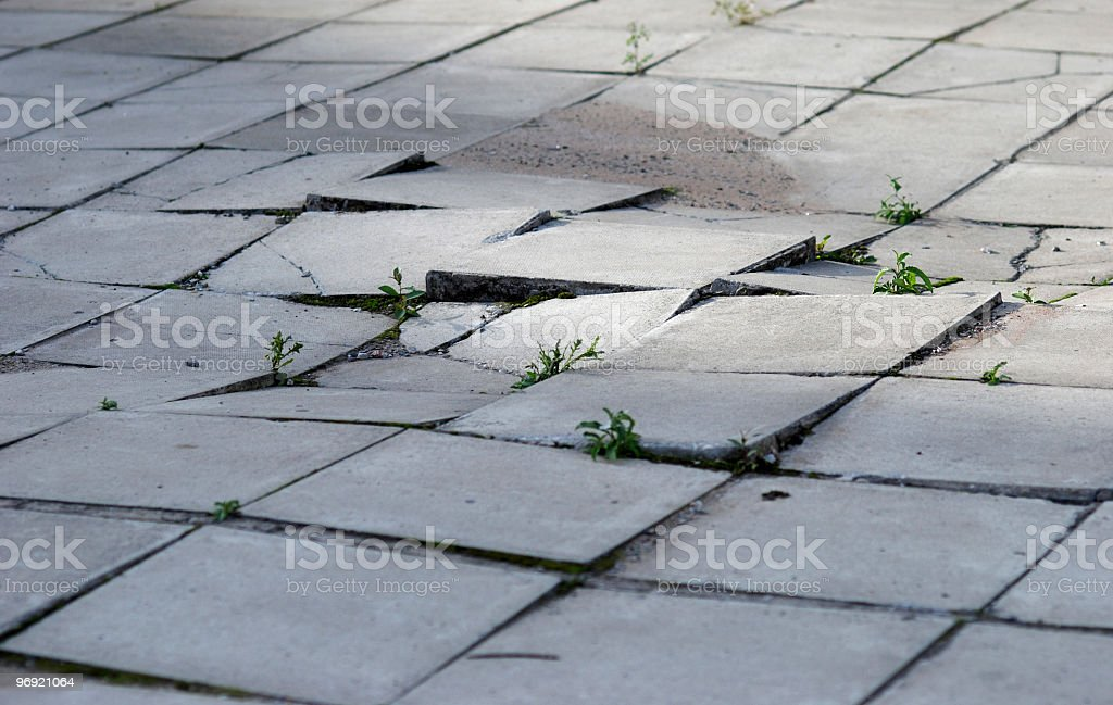 Earthquake effects on sidewalk royalty-free stock photo