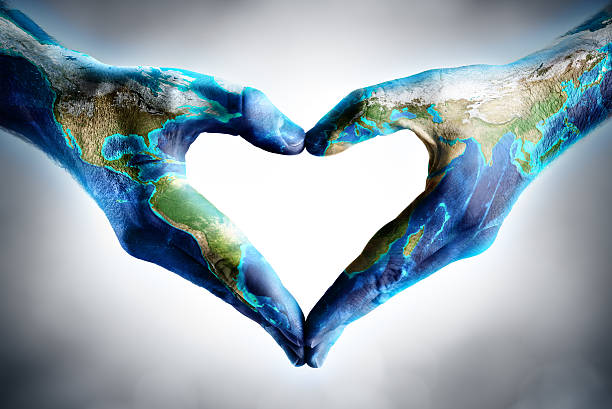 earth's day celebration - hands shaped heart with world map - respect stock photos and pictures
