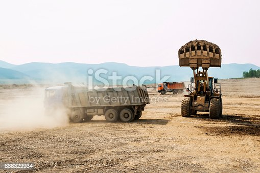 istock Earthwork, working machinery on a summer day 666329934