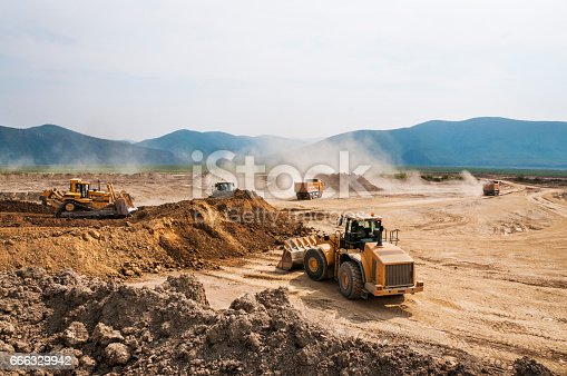 Earthwork, working machinery on a summer day
