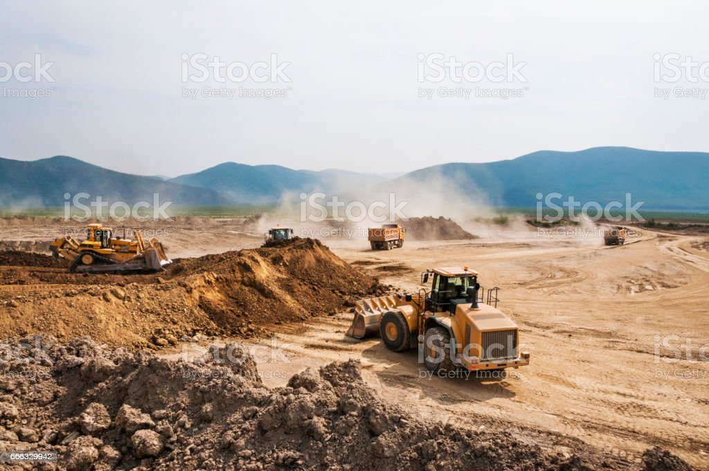 Earthwork, working machinery on a summer day stock photo