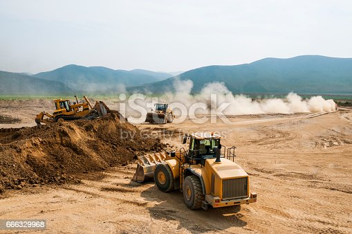 istock Earthwork, working machinery on a summer day 666329968