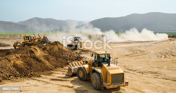 istock Earthwork, working machinery on a summer day 666329990