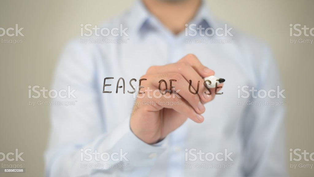 Ease To Use , man writing on transparent screen stock photo