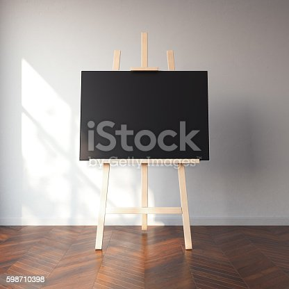 1021586250istockphoto Easel and blank black canvas in bright interior. 3d rendering 598710398