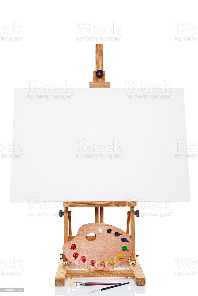 Easel with blank canvas palette paint and brushes isolated royalty-free stock photo