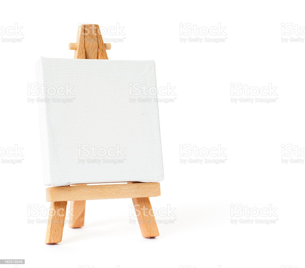 Easel with blank white canvas on white background stock photo