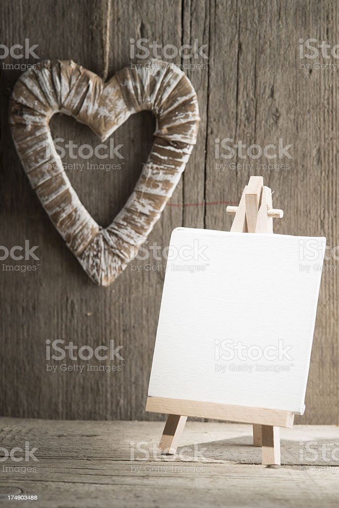 Easel with canvas and heart royalty-free stock photo