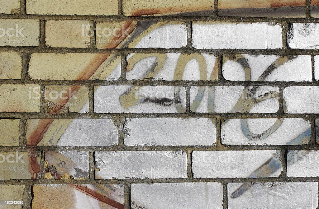 Sgraffito scraffito 2006 on yellow brick wall stock photo