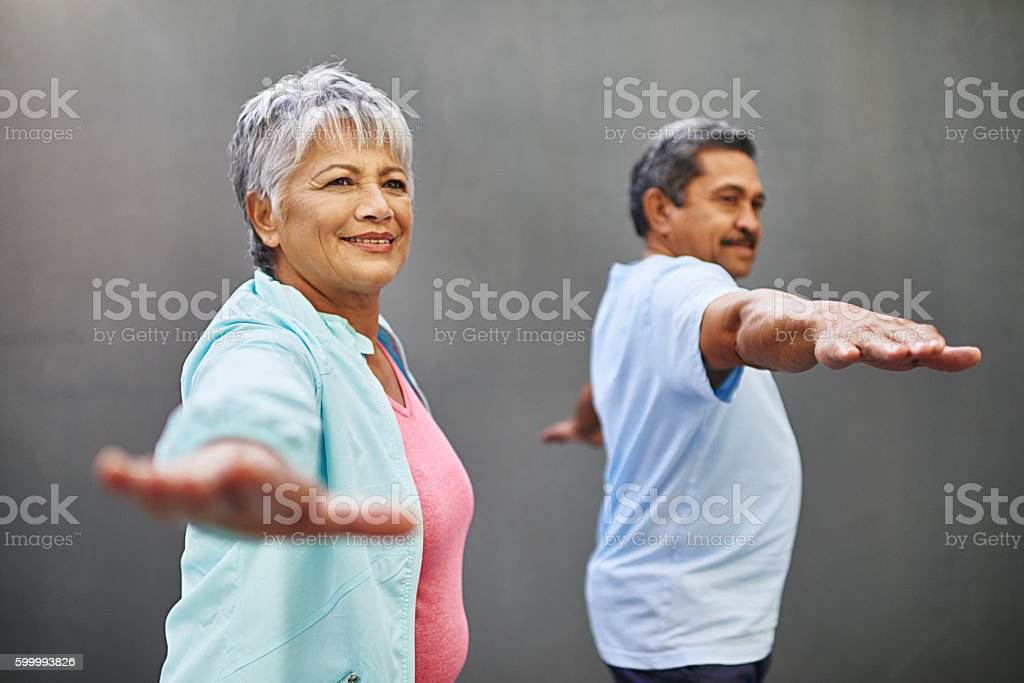 Easing into retirement with some yoga stock photo